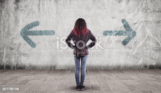 istock Young girl and arrows 521796758