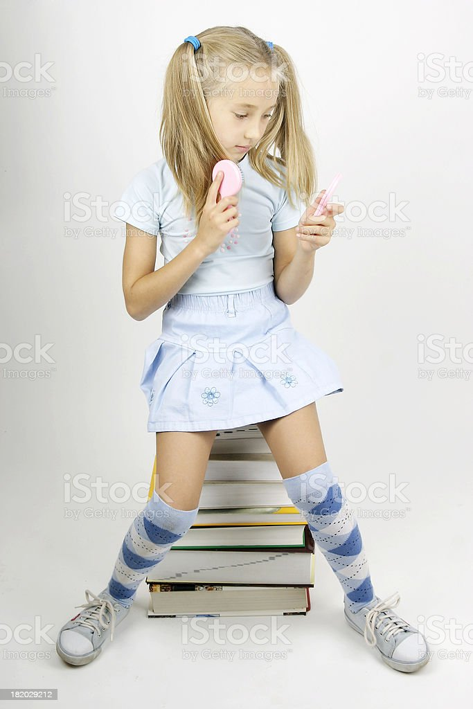 young girl and comb royalty-free stock photo