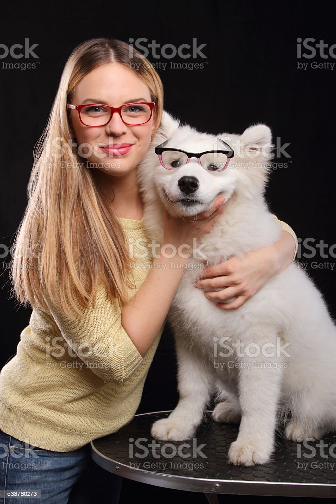 Young girl and dog with glasses stock photo
