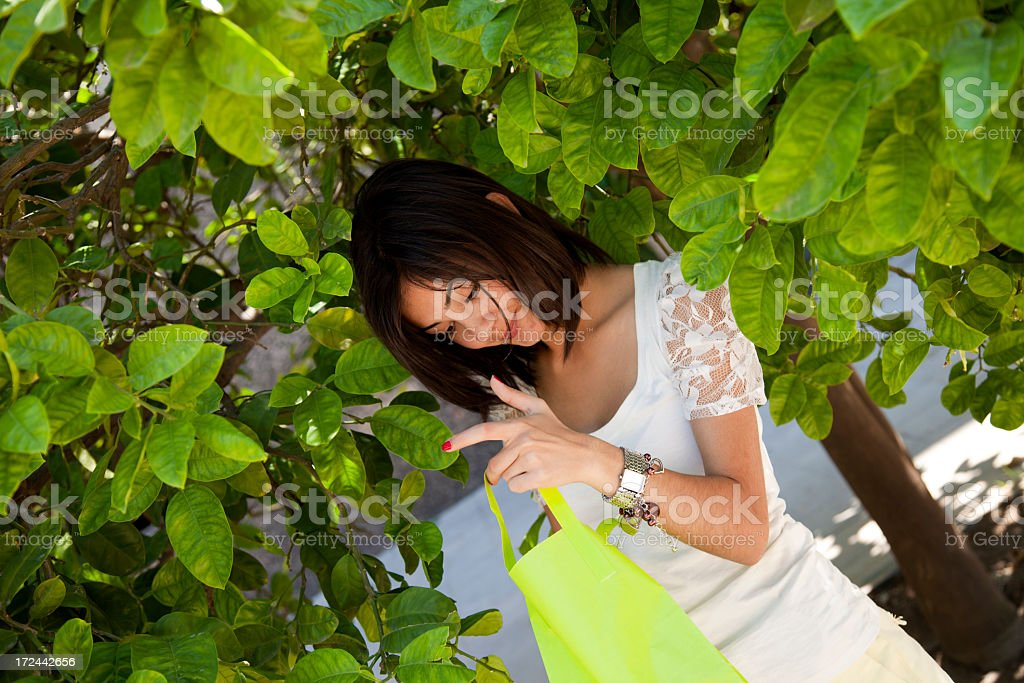 young girl and green shopping bag royalty-free stock photo