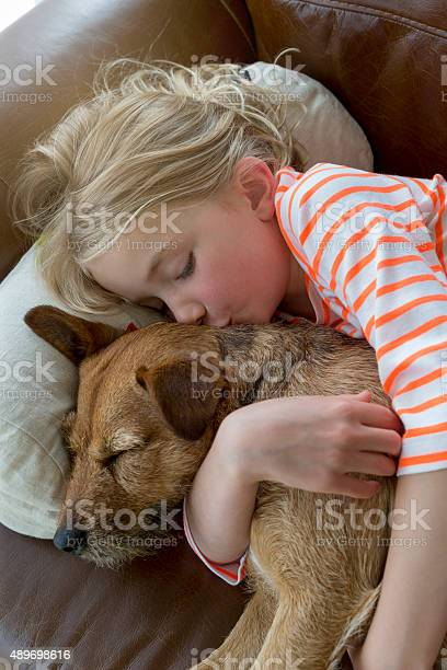 Young girl and her dog cuddling at home picture id489698616?b=1&k=6&m=489698616&s=612x612&h=hbt8reoh9f6zusrw8m5um b8hpdpxvyicecrmx87h64=