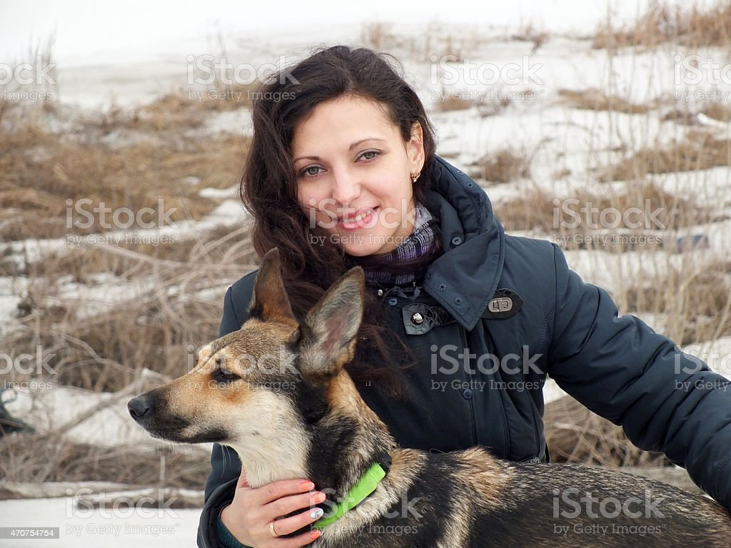 Young girl and her dog stock photo