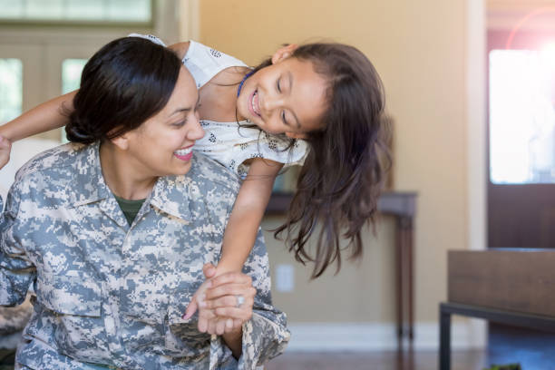 young girl and her mother play with one another - military lifestyle stock pictures, royalty-free photos & images