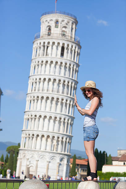 Young Girl and Leaning Tower of Pisa stock photo