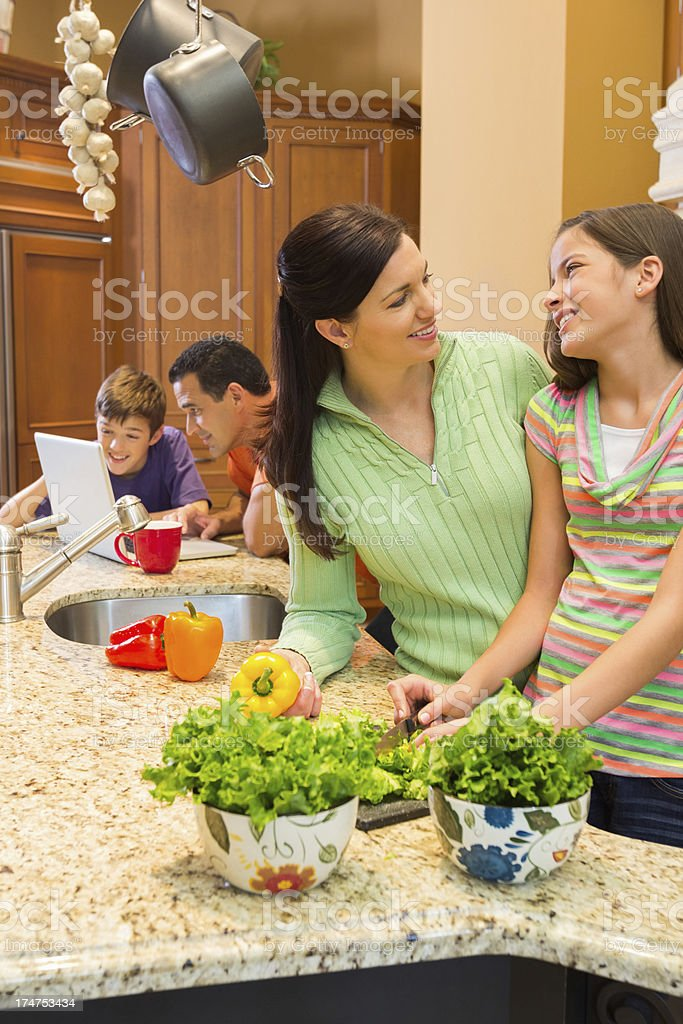 Young Girl And Mother Preparing Food In Kitchen royalty-free stock photo