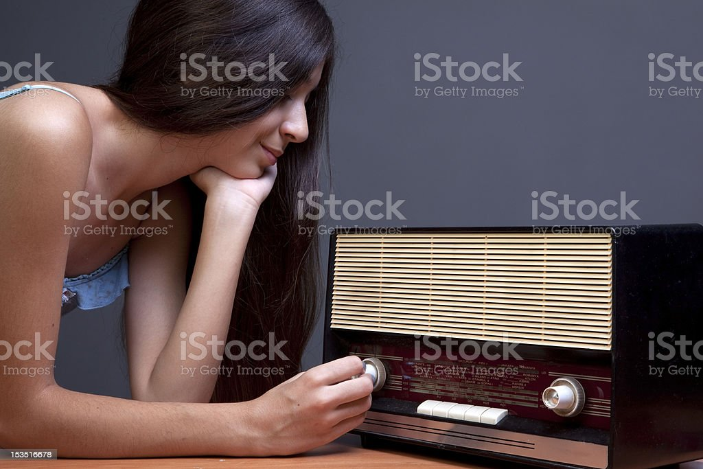 Young Girl And Old Radio royalty-free stock photo