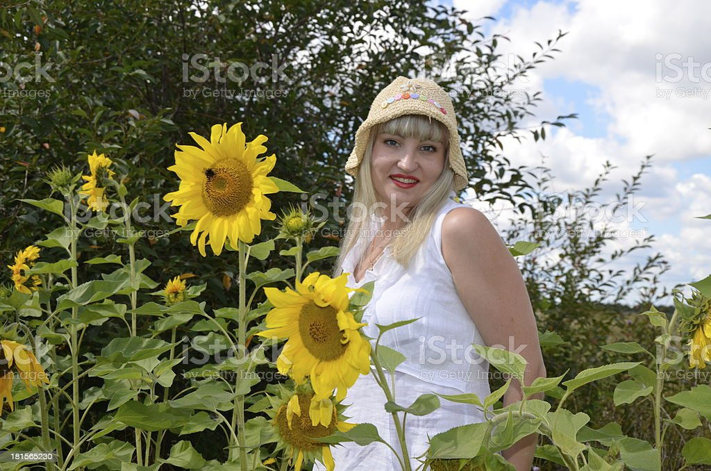 Young girl and sunflowers royalty-free stock photo
