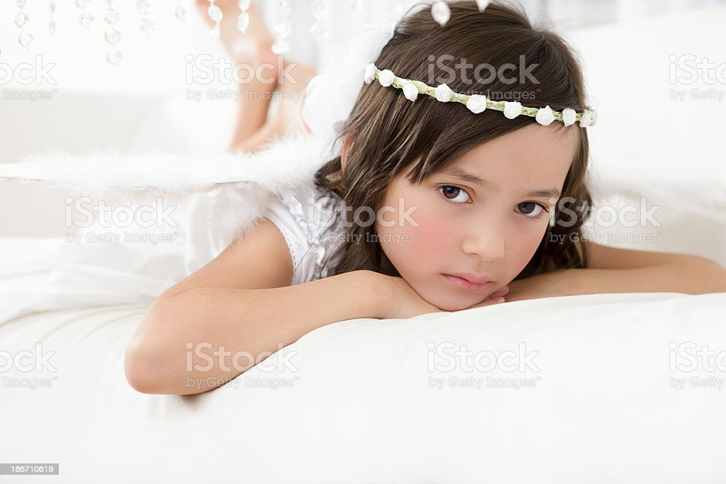 Young girl angel laying on couch royalty-free stock photo