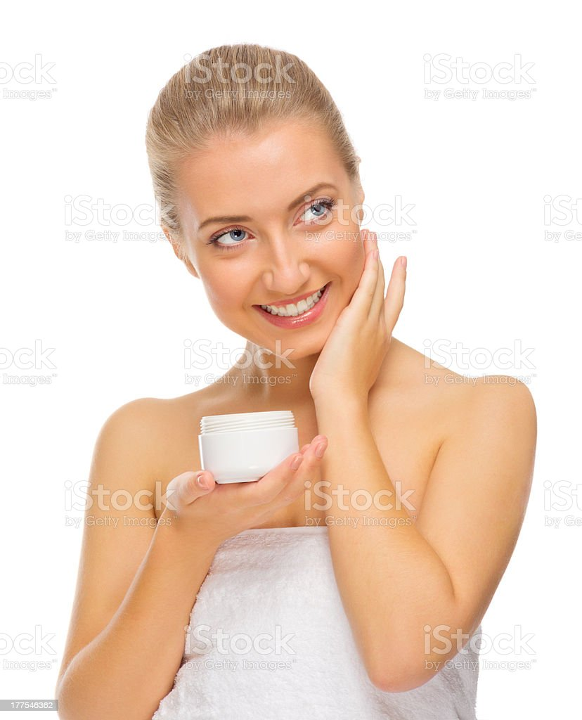 Young girl applying body cream royalty-free stock photo