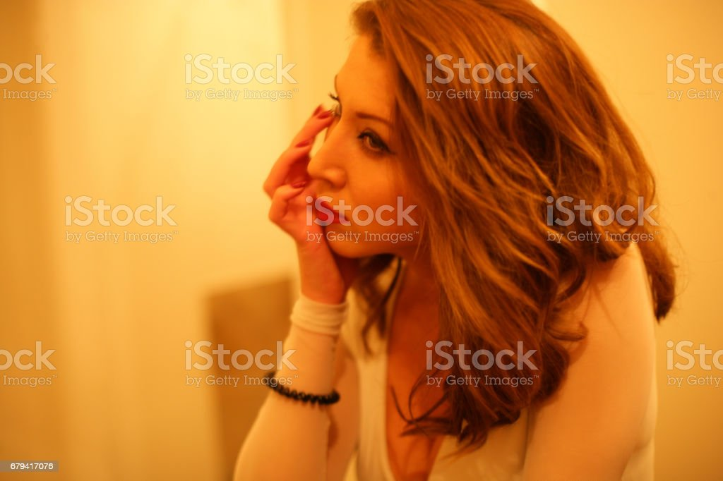 Young girl arranging her make up and hair royalty-free stock photo