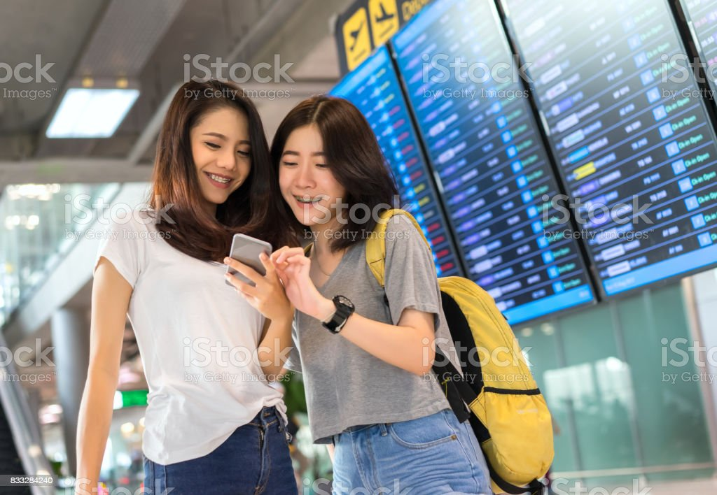 Young Girl Asian Together Using Mobile Smartphone With