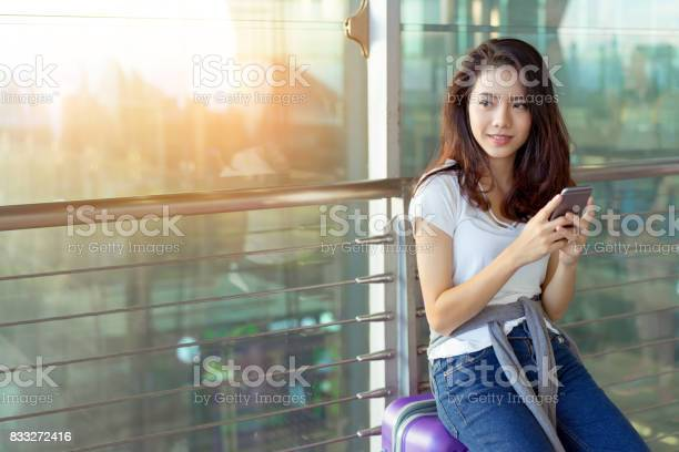 Young girl asian traveler using mobile smartphone with carrying hold picture id833272416?b=1&k=6&m=833272416&s=612x612&h=5z wyk48qgvgm1jrungeo 15cqjysyvp3meav5bmqza=