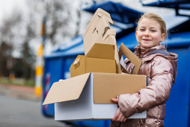 Young girl at a paper recycling centre stock photo