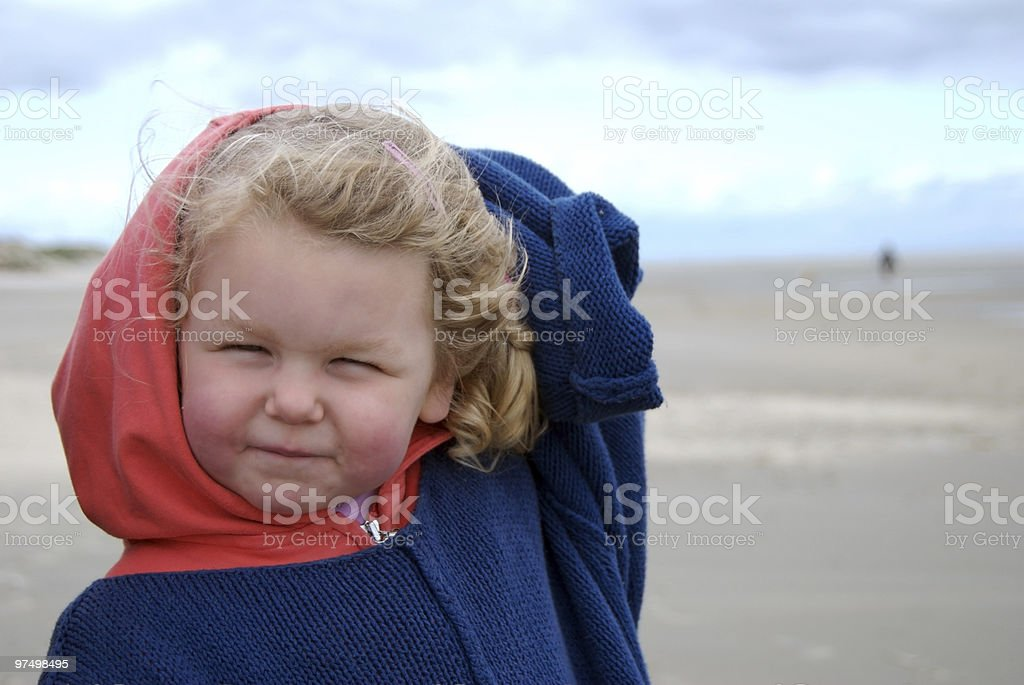 Young girl at beach, wind blowing, summer vacation, copy space royalty-free stock photo