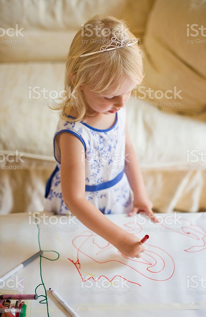 Young girl at birthday party, coloring royalty-free stock photo