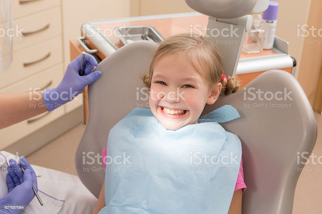 Young girl at dentist., dental treatment stock photo