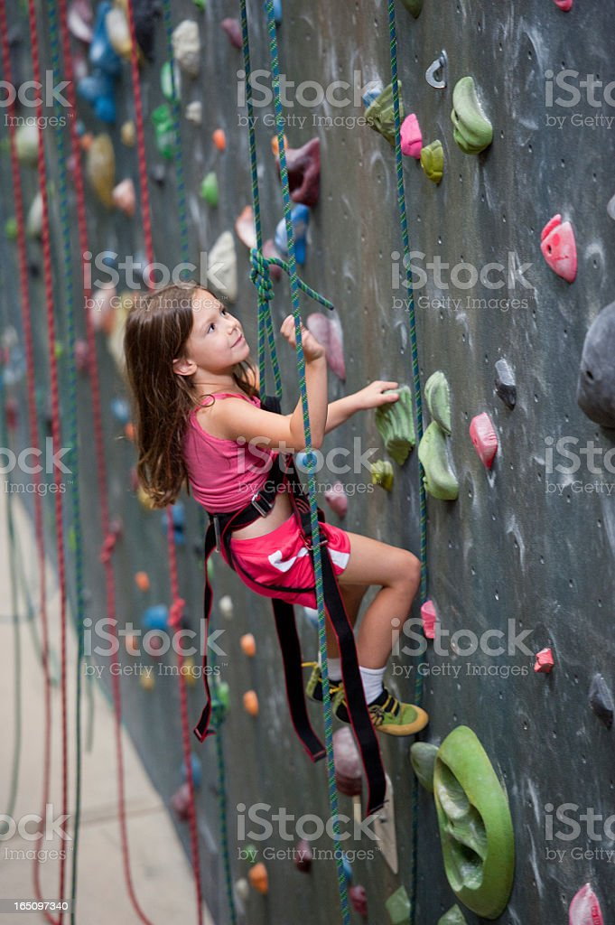 Young Girl at Indoor Climbing Gym stock photo