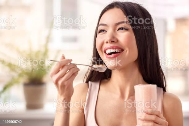 Young girl at kitchen healthy lifestyle standing with glass of with picture id1159909742?b=1&k=6&m=1159909742&s=612x612&h=yl86nxryniepfwvkgyrapbemcxmgpduzabsatjz1kdg=