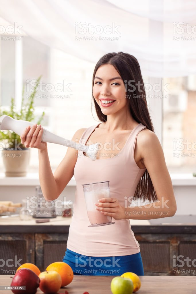 Young Girl At Kitchen Healthy Lifestyle Standing With Hand