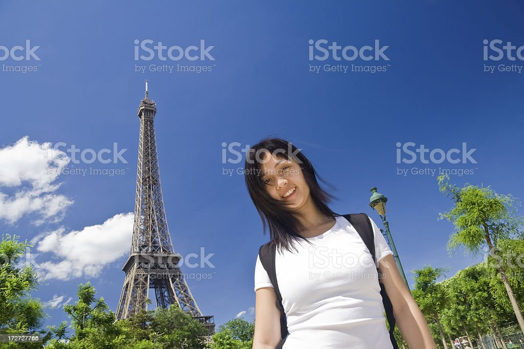 Young girl at the Eiffel Tower royalty-free stock photo