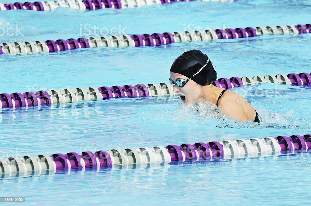 Young Girl Athlete Breaststroke Swimmer Racing in Pool stock photo