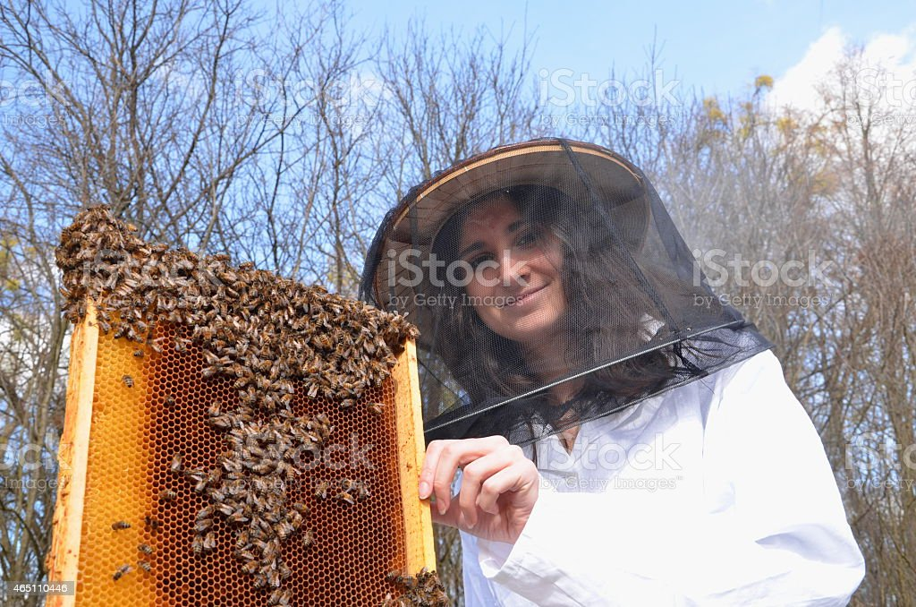 young girl beekeeper in apiary stock photo