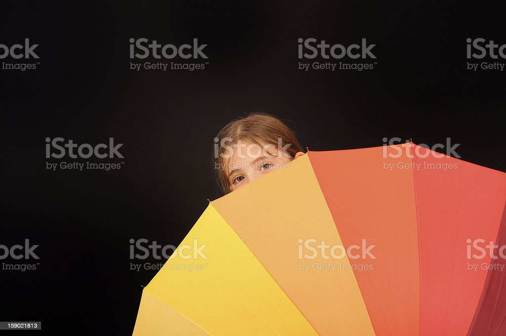 Young girl behind umbrella royalty-free stock photo