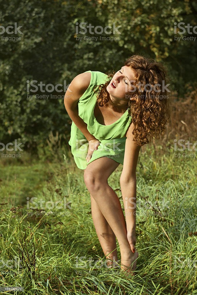 young girl bent over his leg stock photo