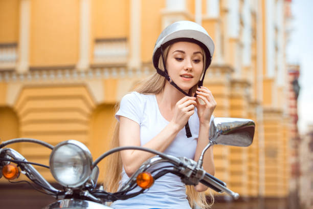 Young girl blonde hair on scooter transportation stock photo