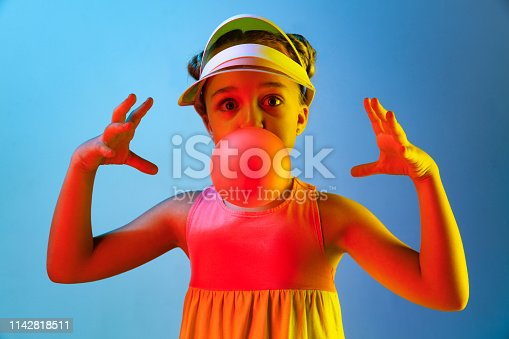 istock Young girl blowing bubble gum 1142818511