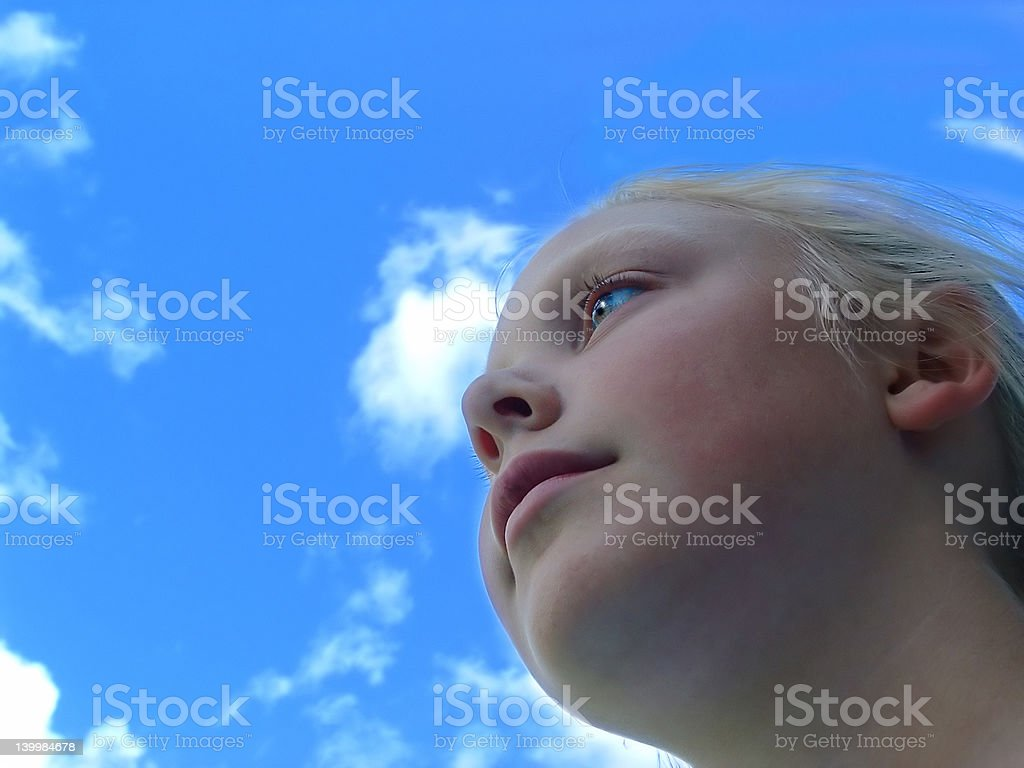 Young Girl Blue Sky stock photo