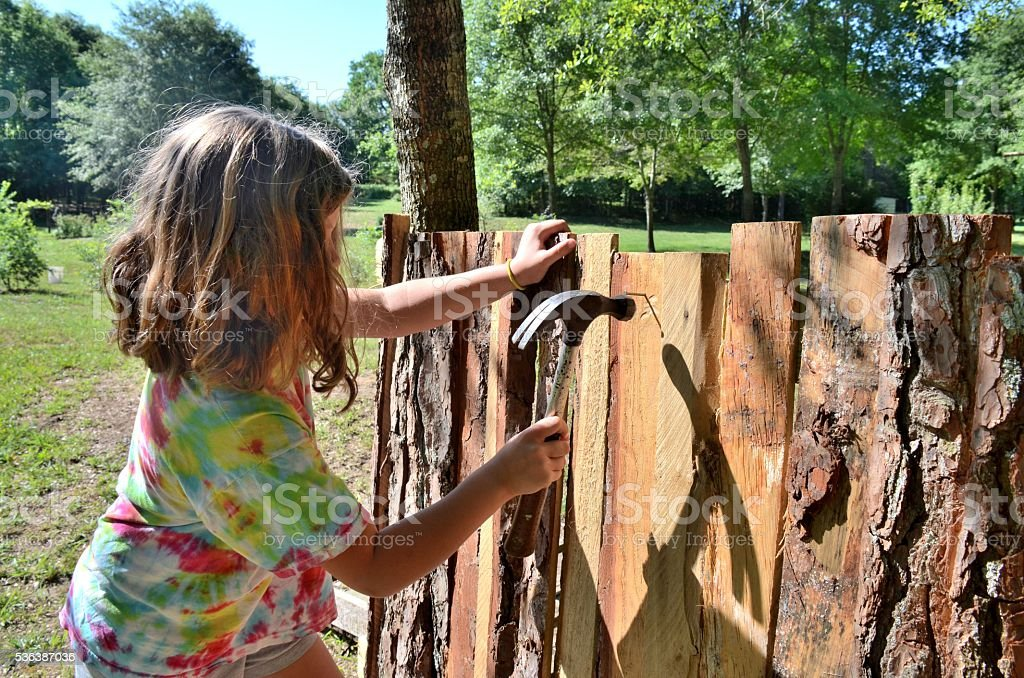 Young girl building playhouse - fort stock photo