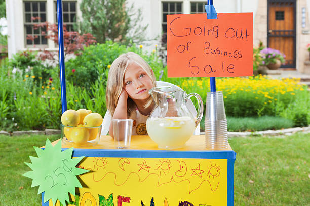 Young Girl Business Entrepreneur with Recession Failing Lemonade Stand Hz Subject: Young girl business entrepreneur owner of a lemonade stand lemonade stand stock pictures, royalty-free photos & images