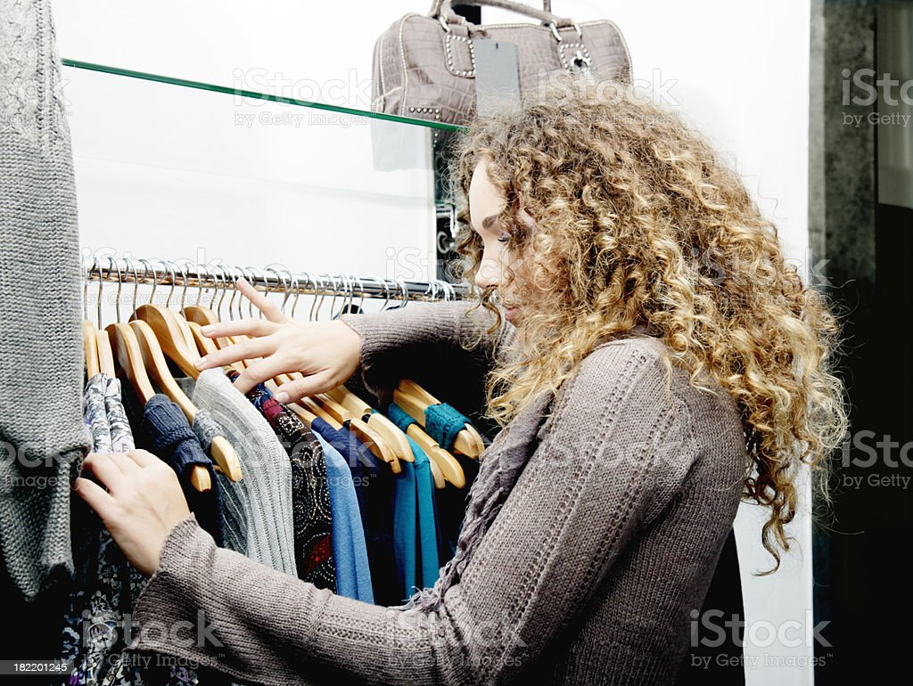 Young girl buying clothes royalty-free stock photo