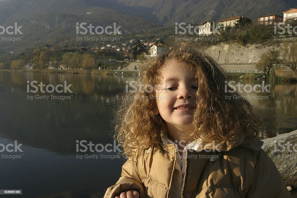 young girl by the lake stock photo