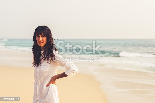 578302556 istock photo A young girl by the ocean on a bright summer day 936639148