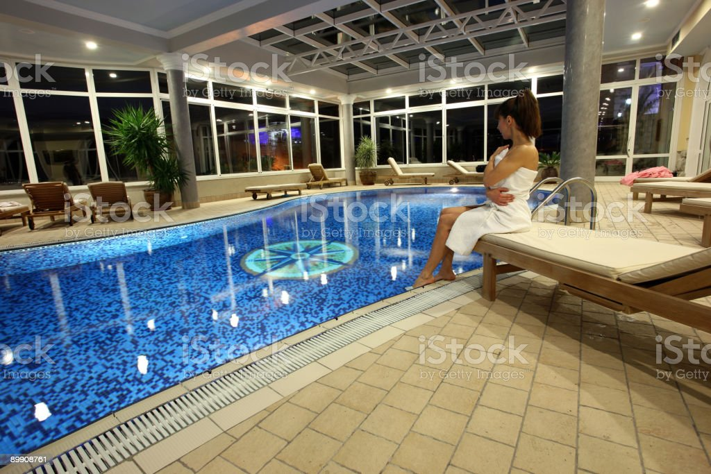 Young girl by the pool royalty-free stock photo