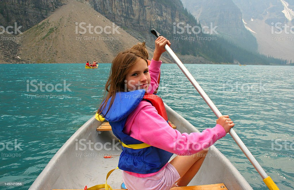 Young girl canoeing. Lake Louise, Canada. royalty-free stock photo