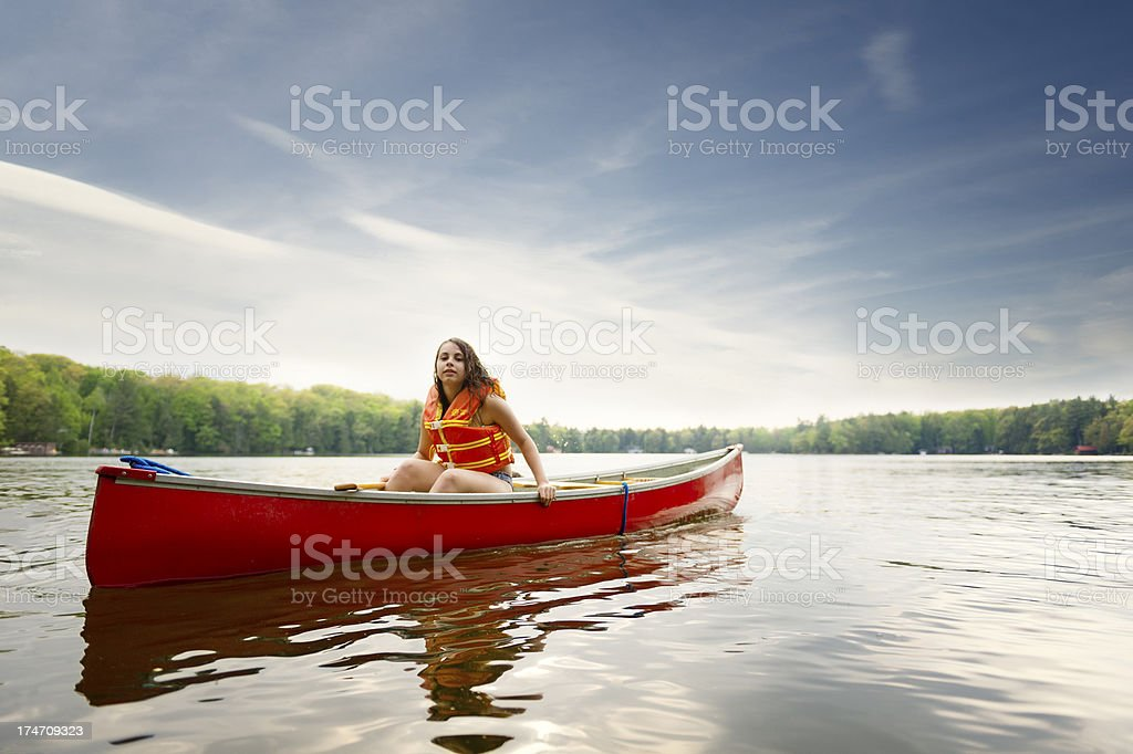 Young girl canoeing stock photo