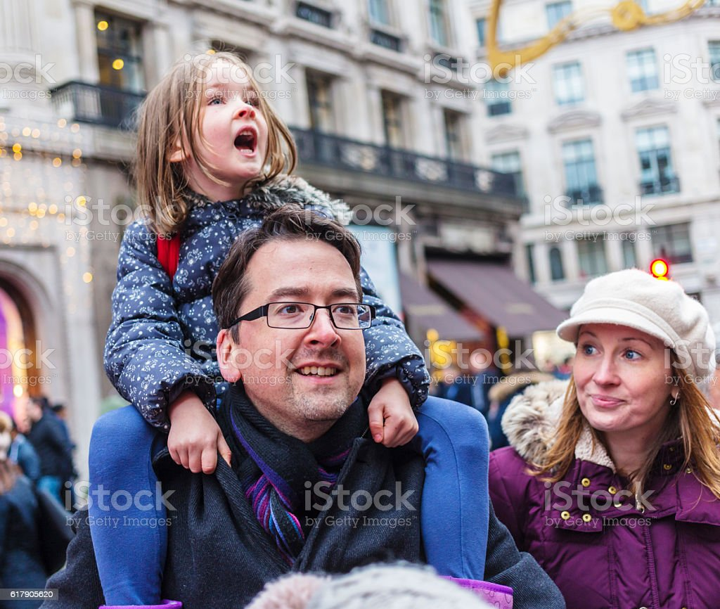Young Girl Carried By Her Father At Winter Christmas Markets - Photo