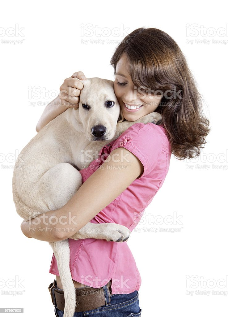 Young girl carrying dog like a child royalty-free stock photo