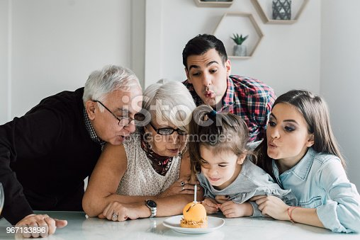 Multi generation family celebrating birthday together