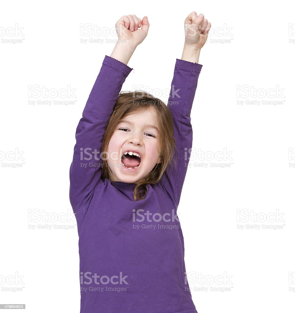 Young girl cheering with raised arms stock photo