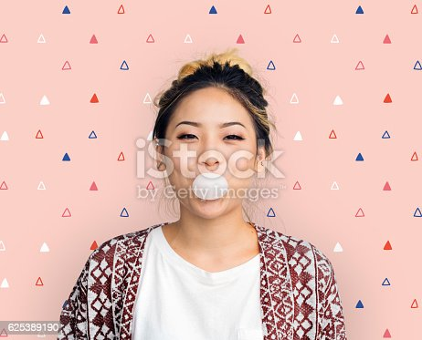 istock Young Girl Chewing Bubble Gum Concept 625389190