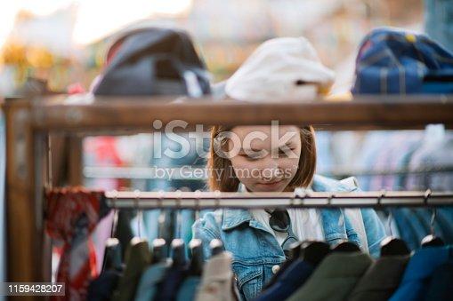 Teenager shopping at a flea market