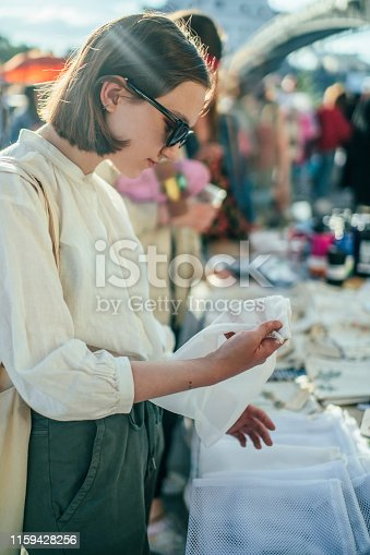 Teenage girl shopping at a market in summer