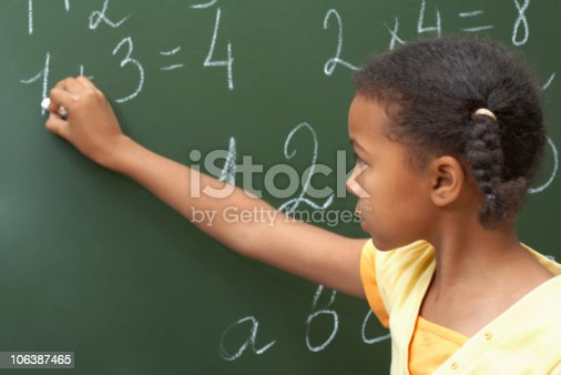 istock Young girl completing sums on a blackboard 106387465