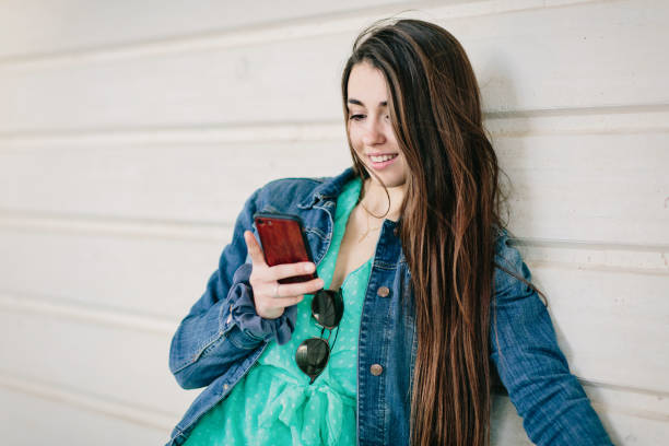 Young girl consulting the smartphone