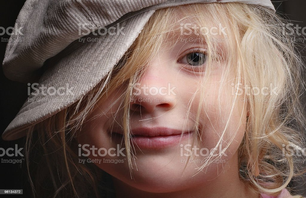 Young girl, cute smile, messy hair and a funky hat royalty-free stock photo