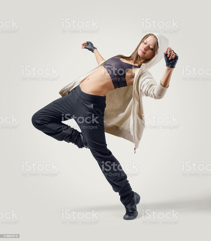 Young girl dancer leaping in Jazz Dance position stock photo